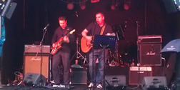 Live picture of Paul playing with 'The Sweet Fantastic' at the Gig in the Garden II festival in London in 2011